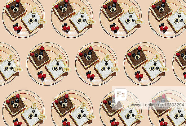 Pattern of plates with toasts decorated with bear faces made of fruits