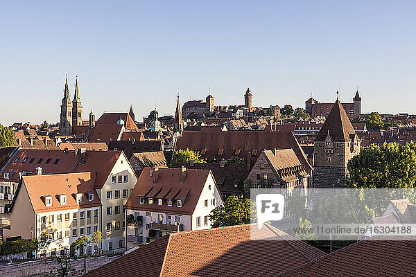 Germany  Bavaria  Nuremberg  Clear sky over historical old town at dusk