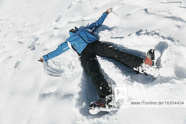 Germany  Bavaria  Winklmoosalm  Mature man making a snow angel