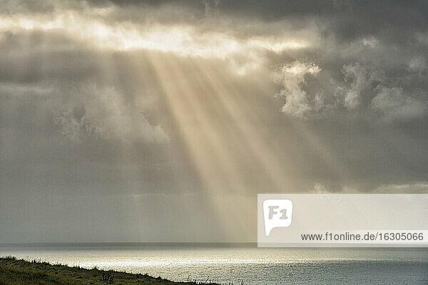 New Zealand  Chatham Island  Sun breaking through clouds