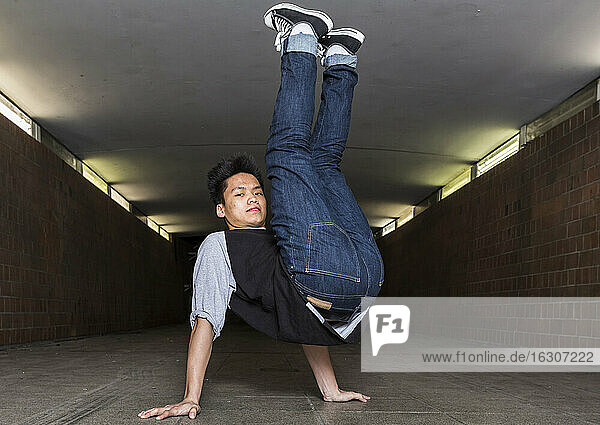 Young breakdancer in underpass