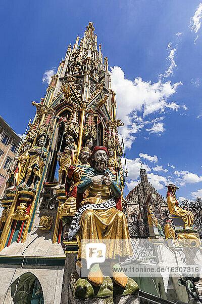 Germany  Bavaria  Nuremberg  Sculptures of historical Schoner Brunnen fountain
