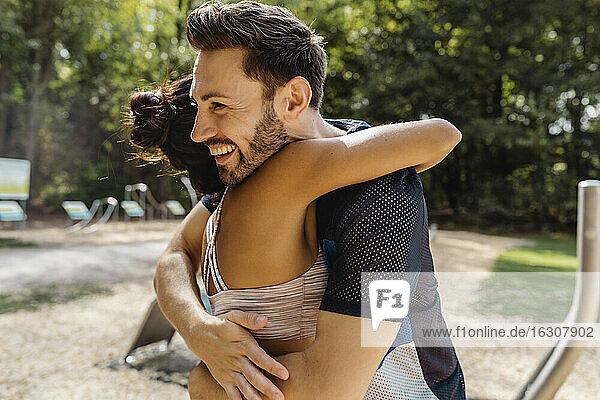 Man and woman hugging on a fitness trail