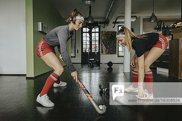Girls practicing hockey in health club