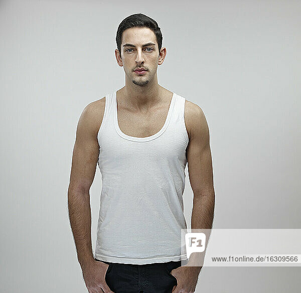 Portrait of young man wearing undershirt