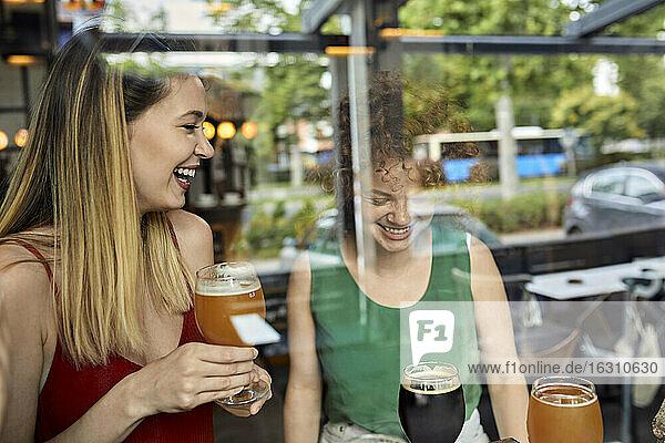 Happy female friends socializing in a pub