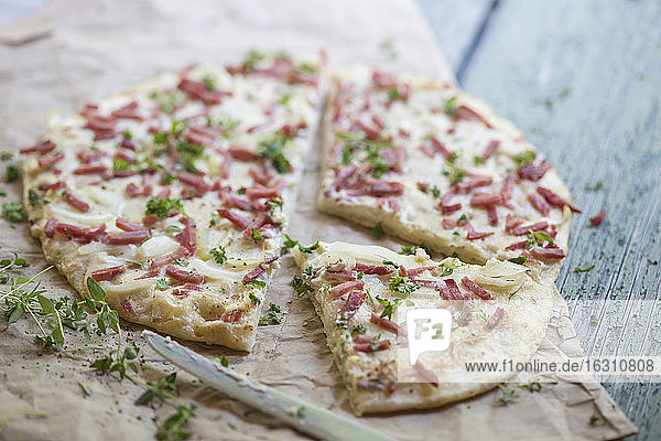 Germany  Tarte with onions and ham on table