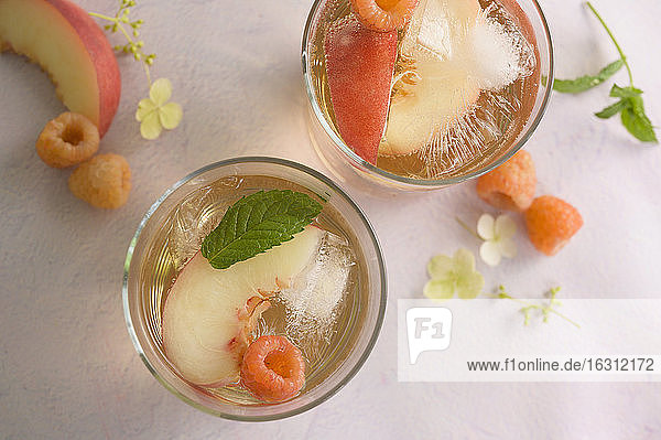 Peach cocktail with fresh raspberries