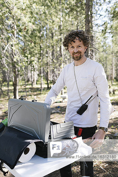 Man cooking at camping in Uinta-Wasatch-Cache National Forest
