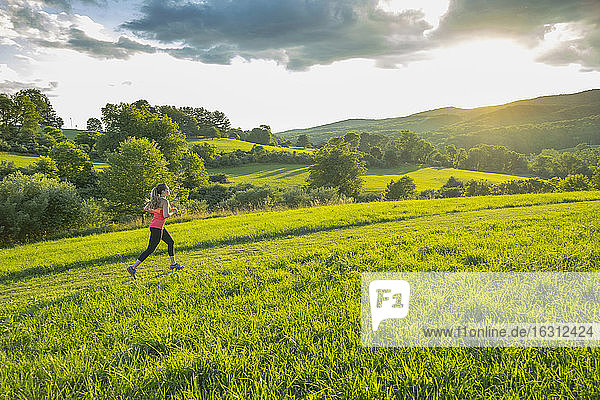 USA  Woman running in field