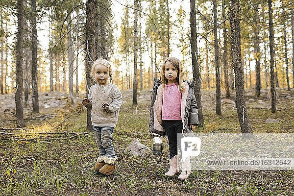 Portrait of two girls (2-3  4-5) standing in forest  Wasatch Cache National Forest