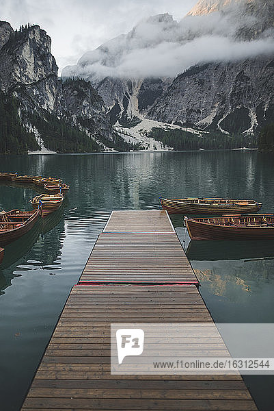 Italy  Pragser Wildsee  Dolomites  South Tyrol  Rowboats moored near jetty in mountain lake