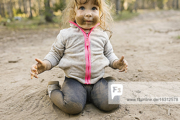 Girl (2-3) playing in sand  Wasatch Cache National Forest