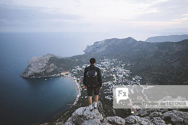 Italy  Liguria  La Spezia  Man looking at mountain range from mountain top