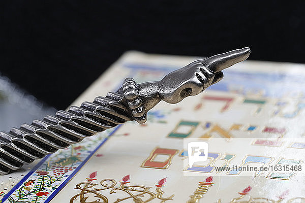 A silver Yad Jewish ritual pointer on a Torah  France  Europe