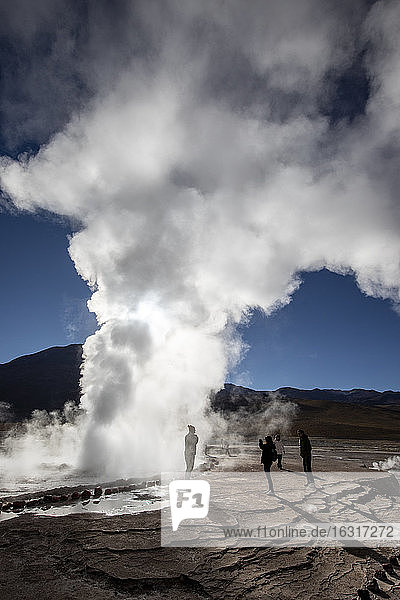 Tourists at the Geysers del Tatio (El Tatio)  the third largest geyser field in the world  Andean Central Volcanic Zone  Antofagasta Region  Chile  South America