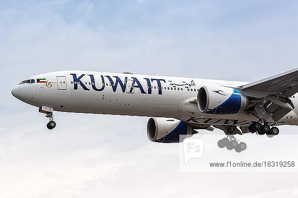 London  10 July 2019: A Kuwait Airways Boeing 777-300ER aircraft with registration mark 9K-AOI is landing at Heathrow Airport (LHR) in the United Kingdom  United Kingdom  Europe