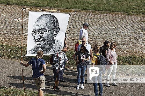 Demo against corona rules on the Rhine meadows  banner with portrait of Mahatma Gandhi  Düsseldorf  North Rhine-Westphalia  Germany  Europe