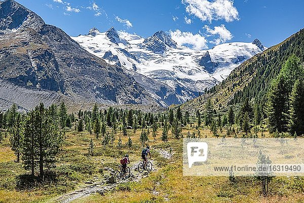 Hiking trail and mountain biking in the Roseg Valley  Val Roseg with Piz Glüschaint and Roseg Glacier  Pontresina  Bernina Alps  Upper Engadine  Engadine  Grisons  Switzerland  Europe