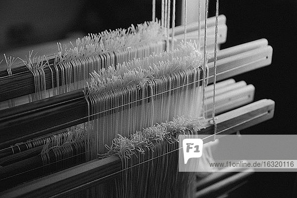 Close up wool on wooden loom
