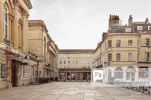 Buildings around empty town square  Bath  Somerset  UK