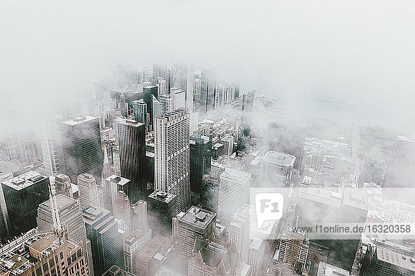 Aerial view highrise buildings in fog  Chicago  Illinois  USA