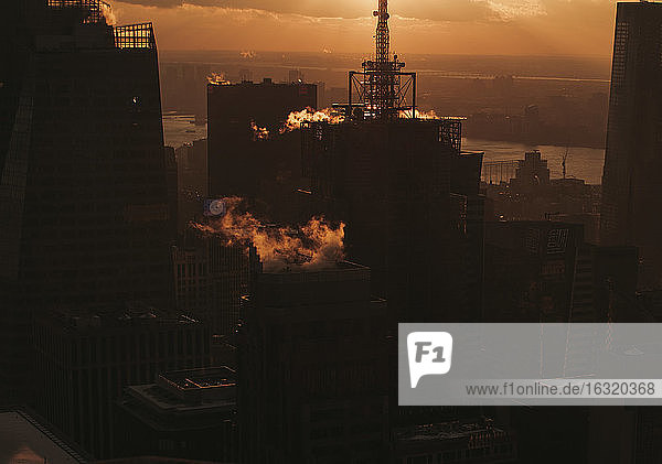 Silhouetted buildings at sunset  New York City  New York  USA
