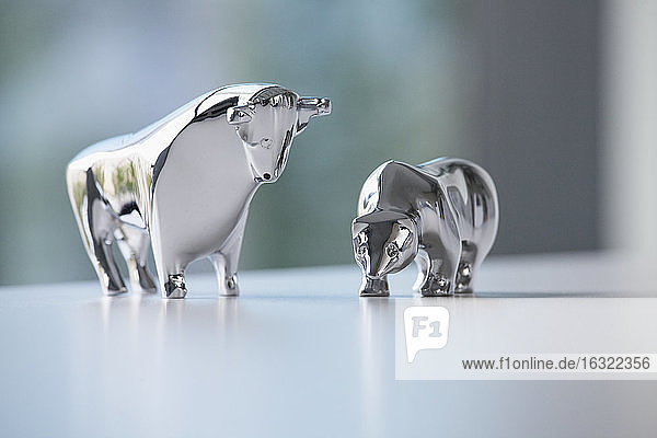 Miniature sculptures of bull and bear on a desk