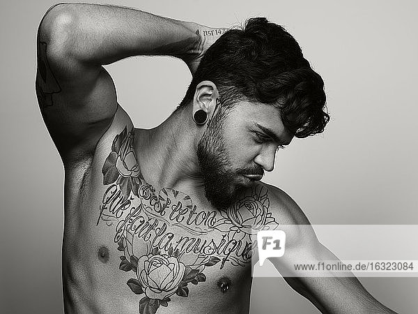 Man with tatoo on his chest