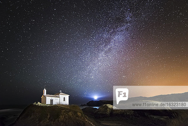 Spain  Galicia  Valdovino  Little chapel Virxe do Porto in the galician coast in a night shot with stars and milky way