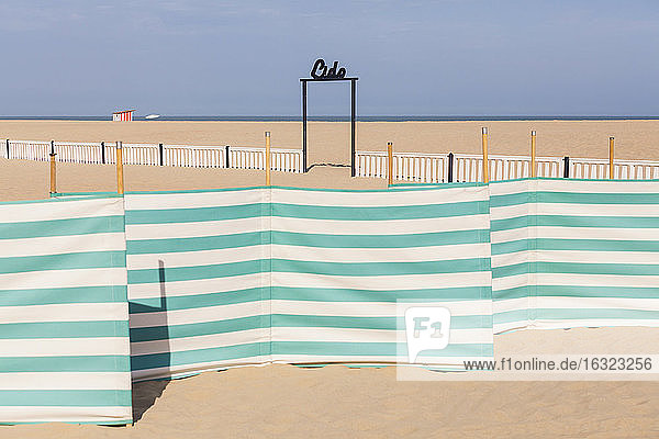 Belgium  Flanders  Ostende  North sea seaside resort  windbreak  sign lido  empty beach