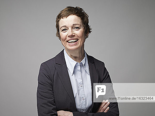 Portrait of smiling mature woman with crossed arms