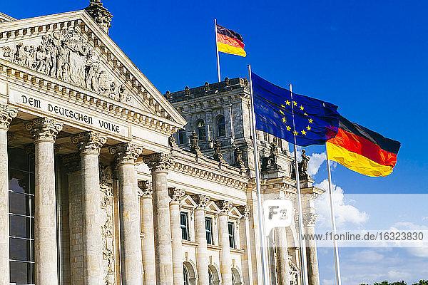 Germany  Berlin  Berlin-Tiergarten  Reichstag building and flags
