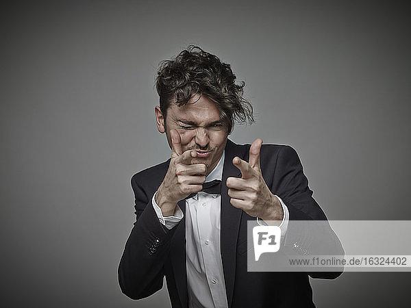 Portrait of man 'shooting' viewer