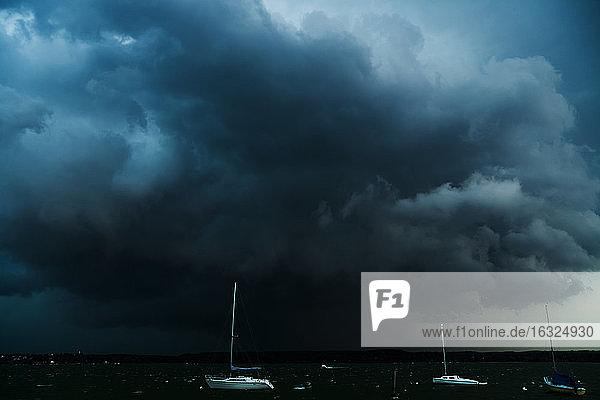 Germany  Stegen at Ammersee  sailing boats at thunderstorm