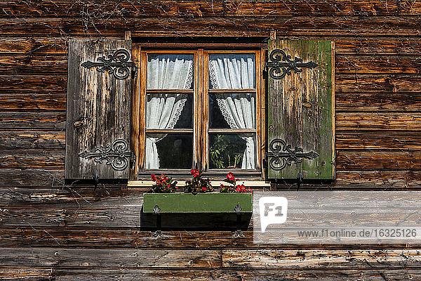 Germany  Bavaria  Schaeftlarn  Window with flower box of a farmhouse