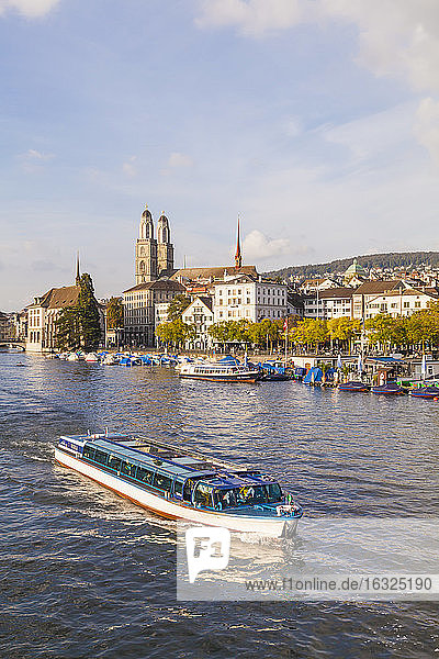 Switzerland  Zurich  view of city with tourboat on Limmat in the foreground