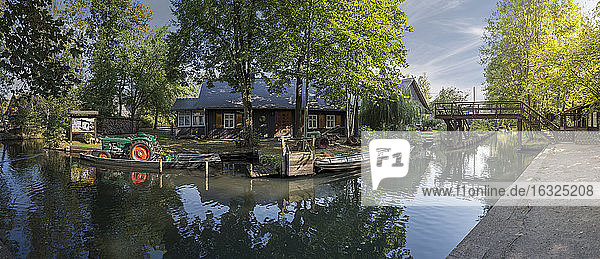 Germany  Spreewald  Lehde  house and tractor at rivershore