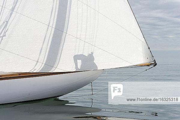Close-up of sailing boat on lake