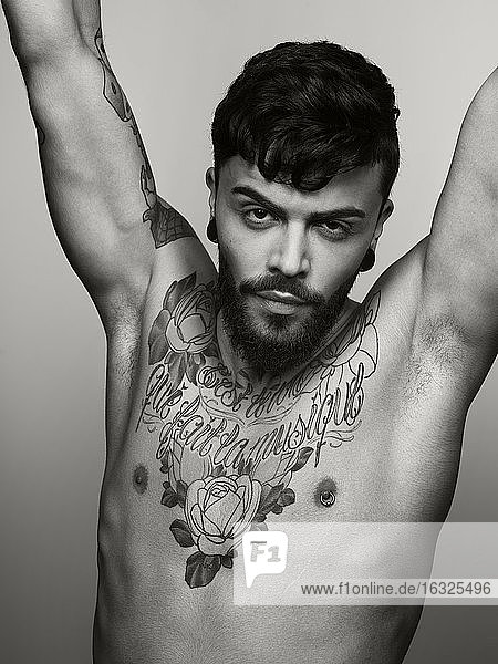 Portrait of man with tatoo on his chest