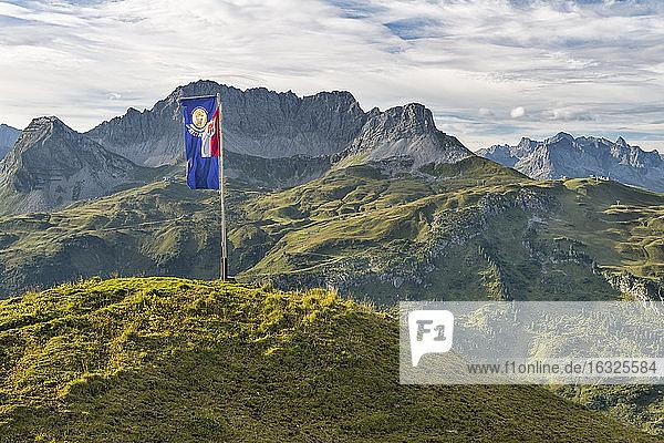 Austria  Vorarlberg  Lechtal  alpine landscape with flag at Widderstein hut