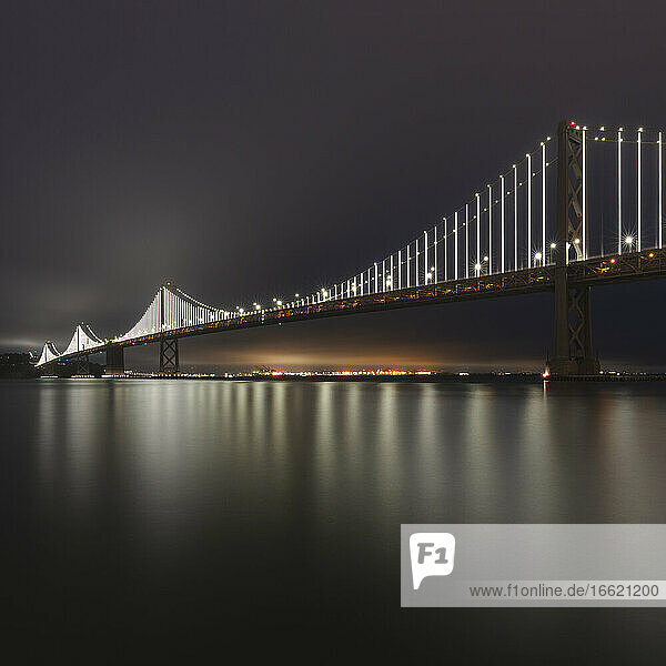 Night view of illuminated Oakland Bay Bridge at San Francisco  California  USA