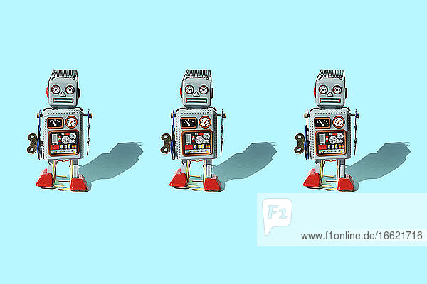 Studio shot of three vintage robot toys