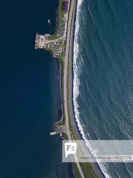 Russia  Primorsky Krai  Zarubino  Aerial view of coastal road stretching along narrow strip of land