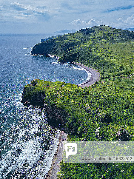 Aerial view of green coastal cliffs of Krabbe Peninsula