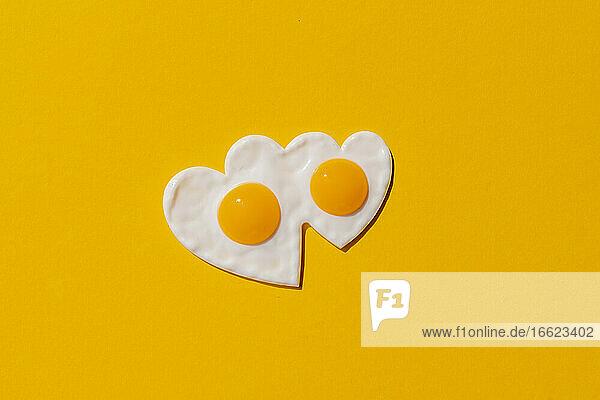 Studio shot of heart shaped fried eggs