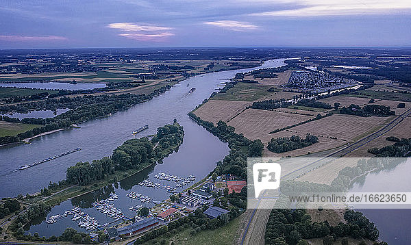 Germany  North Rhine-Westphalia  Wesel  Aerial view of harbor on Wesel-Datteln Canal at dusk