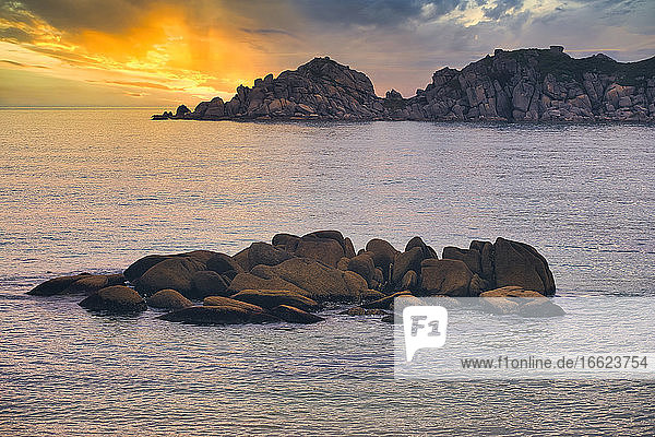 Rocks in sea of Japan against cloudy sky during sunset  Primorsky Krai  Russia