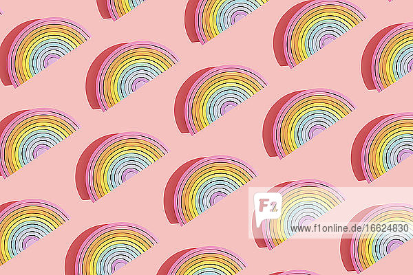 Multiple image of colorful wooden rainbow toys on colored background