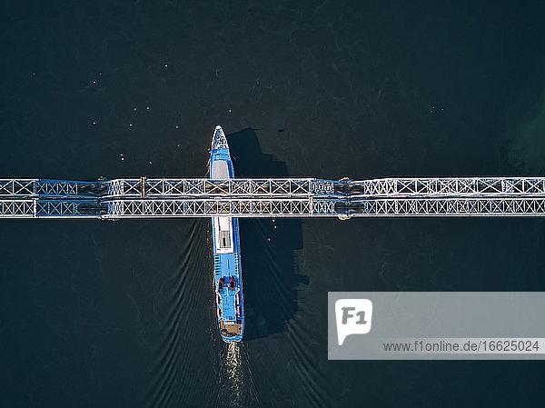 Ship passing below bridge on Volga River